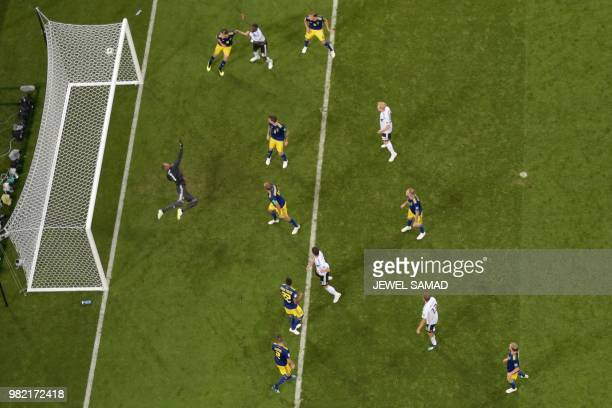 TOPSHOT Sweden's goalkeeper Robin Olsen concedes a goal during the Russia 2018 World Cup Group F football match between Germany and Sweden at the...