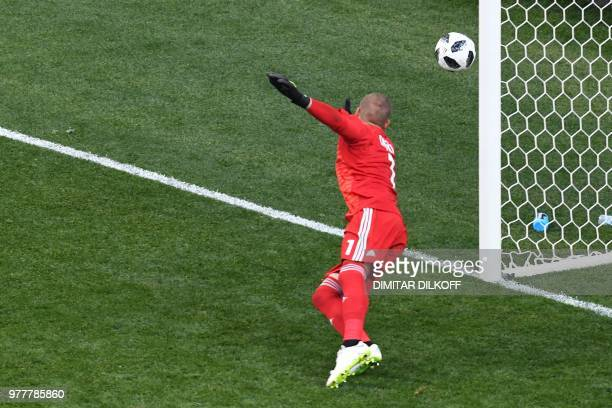 Sweden's goalkeeper Robin Olsen dives as the ball ends up out of bounds during the Russia 2018 World Cup Group F football match between Sweden and...