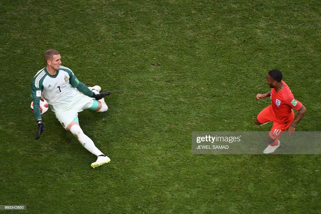 TOPSHOT - Sweden's goalkeeper Robin Olsen (L) saves a shot from England's forward Raheem Sterling (R) during the Russia 2018 World Cup quarter-final football match between Sweden and England at the Samara Arena in Samara on July 7, 2018. (Photo by Jewel SAMAD / AFP) / RESTRICTED