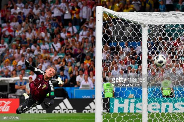 TOPSHOT Sweden's goalkeeper Robin Olsen watchs Germany's midfielder Toni Kroos' free kick go in during the Russia 2018 World Cup Group F football...