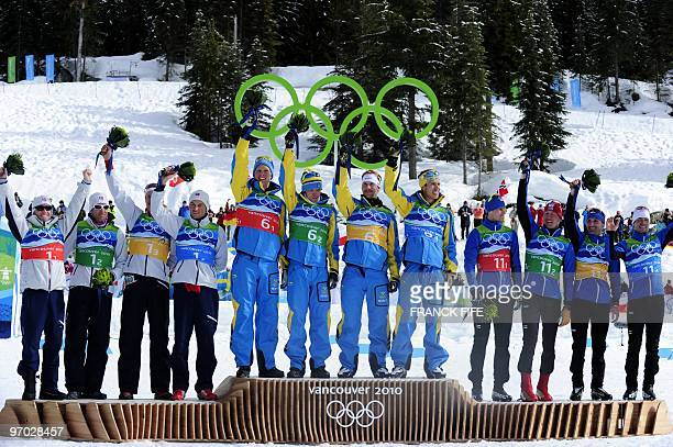 Sweden's gold medalist's Daniel Richardsson Johan Olsson Anders Soedergren and Marcus Hellnerin Norway's silver medalists Norway's Martin Johnsrud...