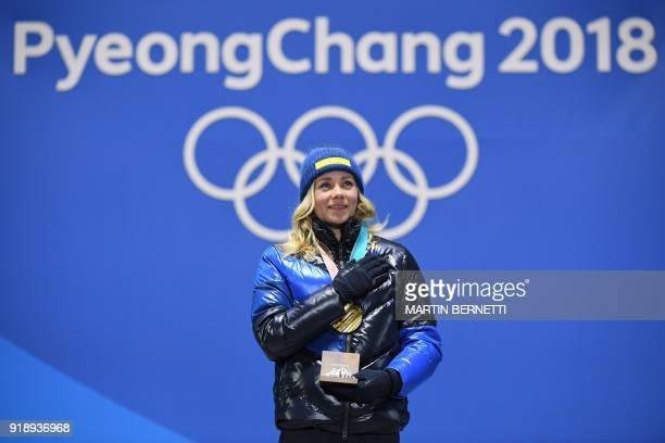 Sweden's gold medallist Frida Hansdotter poses on the podium during the medal ceremony for the alpine skiing women's slalom at the Pyeongchang Medals...