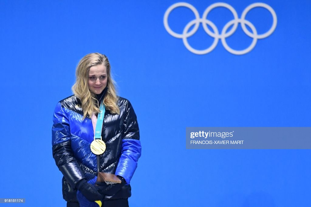 Sweden's gold medallist Stina Nilsson cries of joy on the podium during the medal ceremony for the women's cross country sprint classic at the Pyeongchang Medals Plaza during the Pyeongchang 2018 Winter Olympic Games in Pyeongchang on February 14, 2018. / AFP PHOTO / François-Xavier MARIT