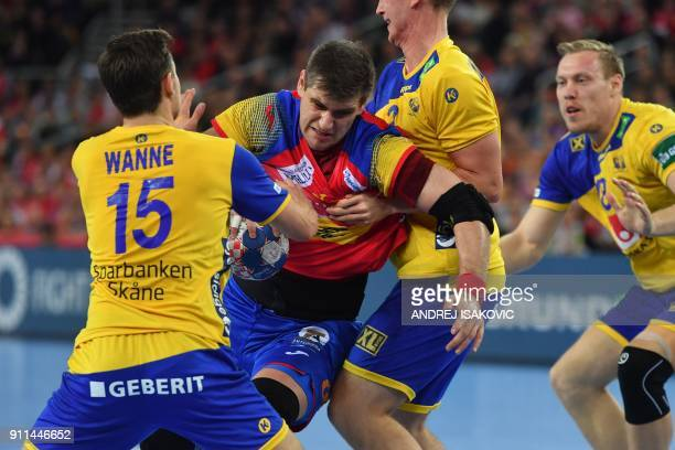 Sweden's Hampus Wanne and Sweden's Philip Henningsson hold off Spain's Julen Aguinagalde during the final match of the Men's 2018 EHF European...
