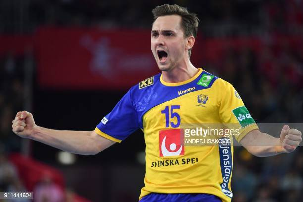 Sweden's Hampus Wanne celebrates scoring during the final match of the Men's 2018 EHF European Handball Championship between Spain and Sweden on...