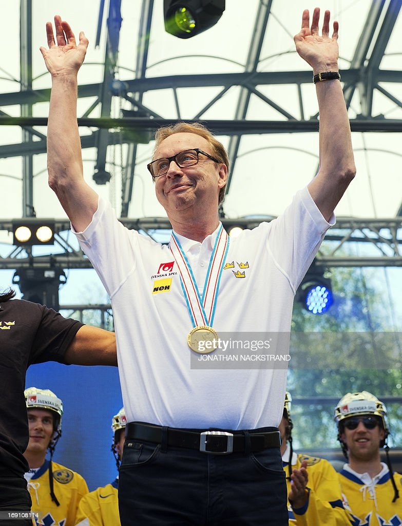 Sweden's head coach Par Marts reacts with his gold medal during a victory celebration a day after winning the 2013 IIHF Ice Hockey World Championship, on May 20, 2013 in Stockholm.