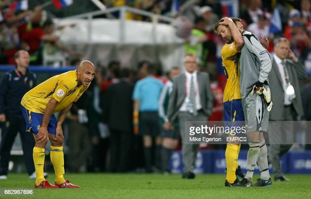 Sweden's Henrik Larsson Kim Kallstrom and Andreas Isaksson look dejected after the final whistle