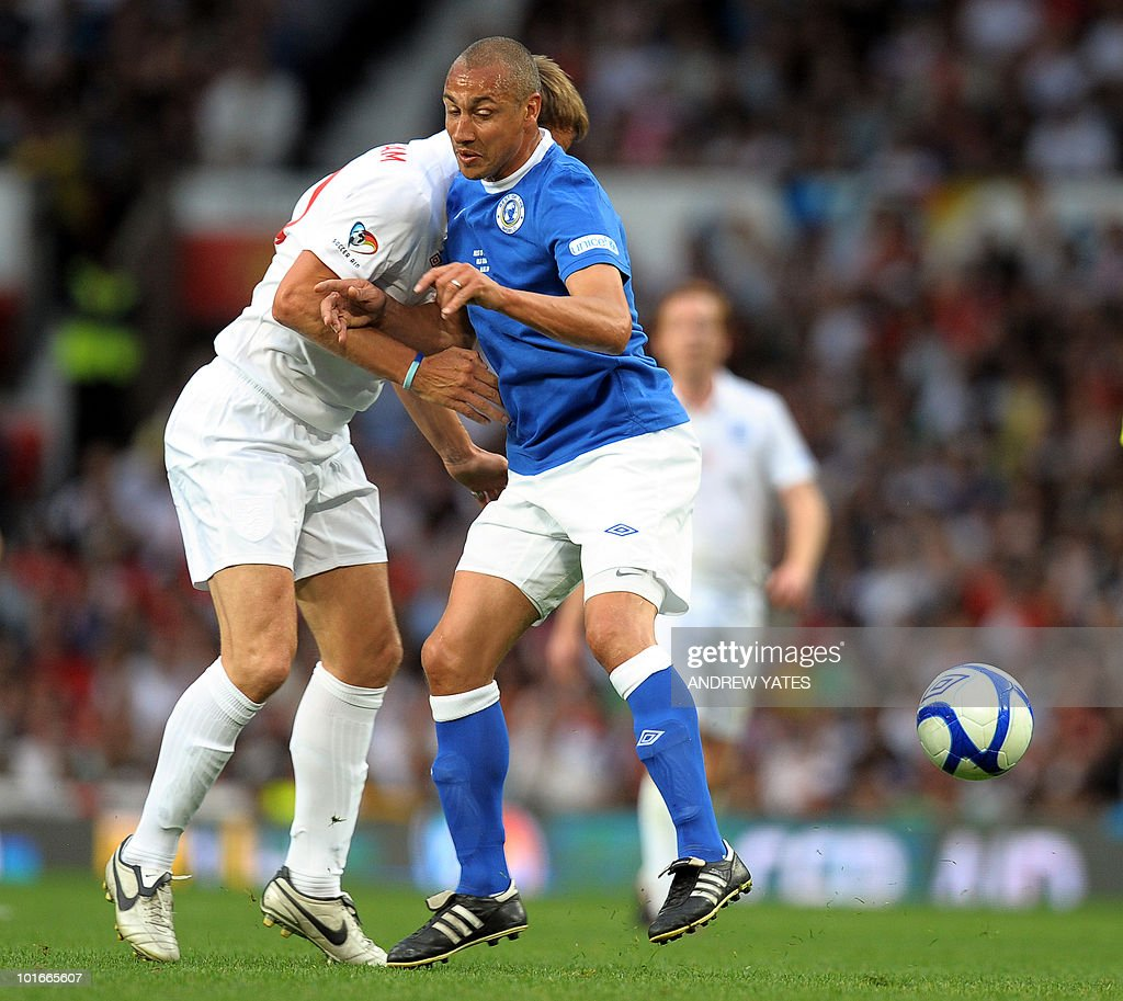 Sweden's Henrik Larsson (R) tussles with England's Teddy Sheringham during the Unicef Soccer Aid charity football match at Old Trafford in Manchester, north-west England on June 6, 2010. Soccer Aid is the brainchild of Robbie Williams and all money raised through profits from ticket sales and donations made by viewers of ITV channel during the match will go to UNICEF�s work helping children around the world.