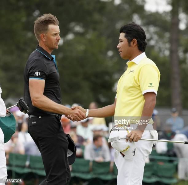Sweden's Henrik Stenson and playing partner Hideki Matsuyama of Japan shake hands after their final rounds of the Masters Tournament at Augusta...