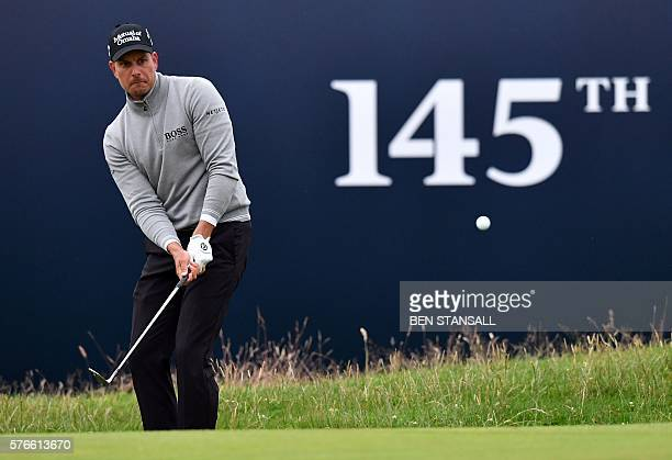 Sweden's Henrik Stenson chips onto the 18th green during his third round 68 on day three of the 2016 British Open Golf Championship at Royal Troon in...