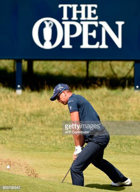 Sweden's Henrik Stenson plays from a greenside bunker on the 6th hole during his third round on day three of the Open Golf Championship at Royal...