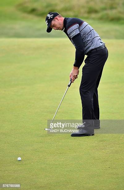 Sweden's Henrik Stenson putts on the 8th green during his final round on day four of the 2016 British Open Golf Championship at Royal Troon in...