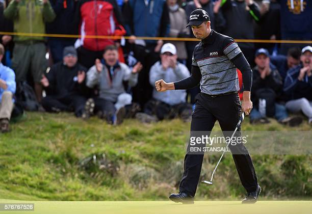 Sweden's Henrik Stenson reacts after making his birdie putt on the 14th green during his final round on day four of the 2016 British Open Golf...