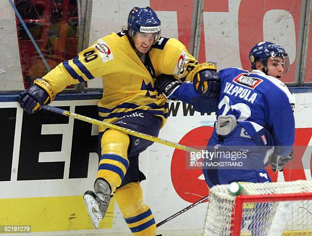Sweden's Henrik Zetterberg, who plays with Detroit Red Wings in the NHL, is pushed by Finland's Valteri Filippula at the Sweden Hockey Games in...
