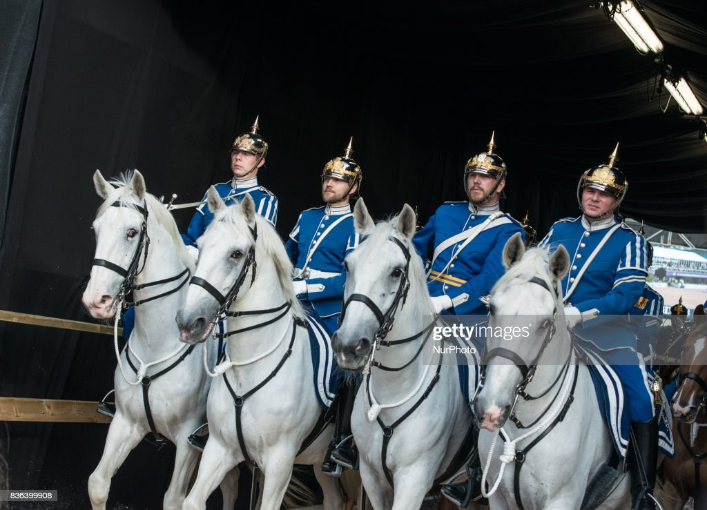 Sweden's honorary guard rides into Ullevi stadium in Gothenburg, Sweden during the opening ceremony of the 2017 Longines FEI European Championship as Princess Madeleine arrives at the stadium for the ribbon cutting ceremony