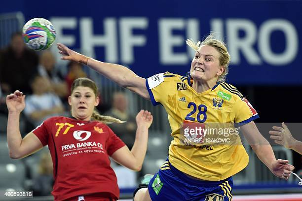 Sweden's Ida Oden shoots the ball past Montenegro's Majda Mehmedovic during the Main Round Group 2 match Sweden vs Montenegro of the 2014 Women's...