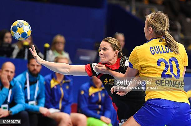 Sweden's Isabelle Gullden and Germany's Anna Loerper vie for the ball during the Women's European Handball Championship Group I match between Sweden...
