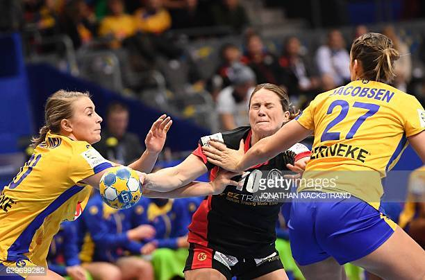 Sweden's Isabelle Gullden and Sabina Jacobsen vie with Germany's Anna Loerper during the Women's European Handball Championship Group I match between...
