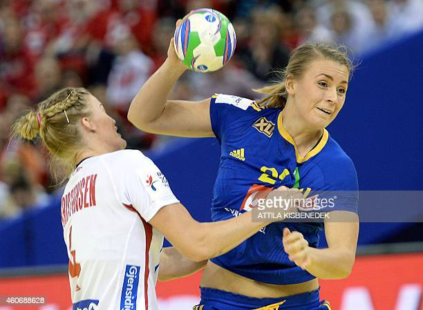 Sweden's Isabelle Gullden scores a goal against Norway's Veronica Kristiansen in Papp Laszlo Arena of Budapest on December 19, 2014 during their...