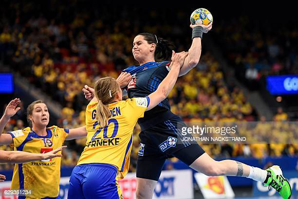 TOPSHOT Sweden's Isabelle Gullden stops France's Alexandra Lacrabere as she prepares to throw the ball during the Women's European Handball...