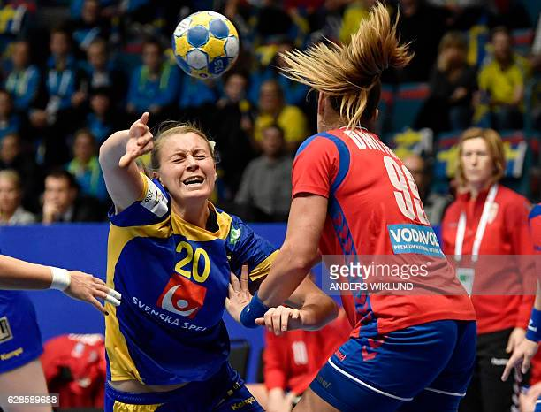 Sweden's Isabelle Gullden throws the ball during the Women's European Handball Championship Group A match Sweden v Serbia in Stockholm, Sweden on...
