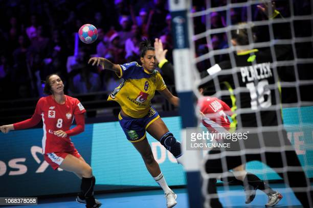Sweden's Jamina Roberts shots in front ofPoland's goalkeeper Adrianna Placzek during the Women Euro 2018 handball Championships group A preliminary...
