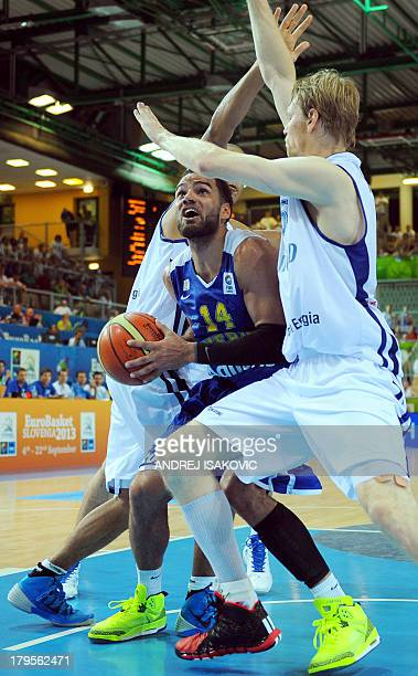 Sweden's Jeffery Taylor challenges Finland's Kimmo Muurinen and Shawn Huff during the 2013 EuroBasket Championship group D match between Finland and...