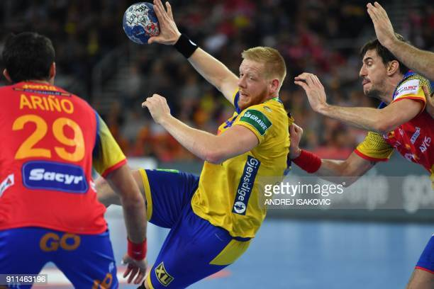 Sweden's Jim Gottfridsson attempts to shoot on goal despite Spain's Aitor Arino and Spain's Viran Morros de Argila during the final match of the...