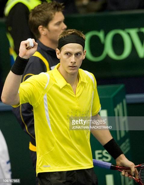 Sweden's Joachim Johansson jubilates after winning against Russia's Teymuraz Gabashvili during their Davis Cup first round singles match in...