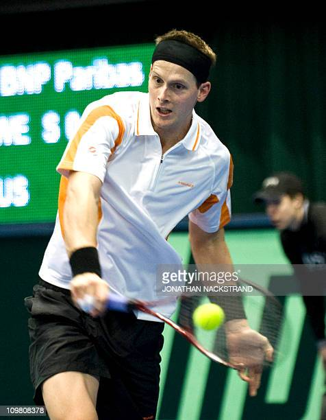 Sweden's Joachim Johansson returns the ball to Russia's Igor Andreev during their Davis Cup first round singles match at the Borashallen stadium in...