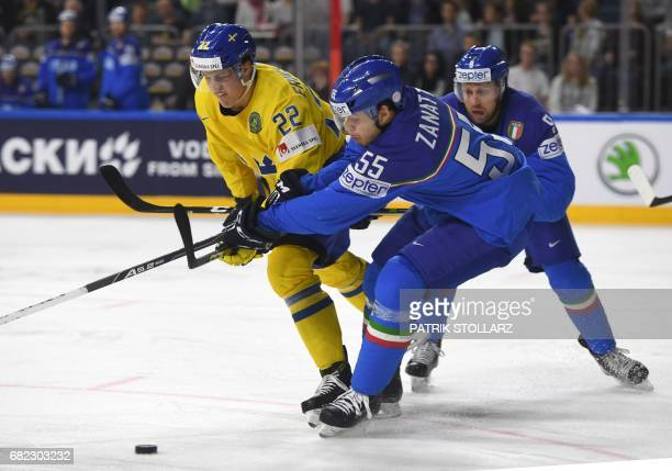 Sweden´s Joel Ek Eriksson and Italy´s Luca Zanatta vie during the IIHF Ice Hockey World Championships first round match between Sweden and Italy in...
