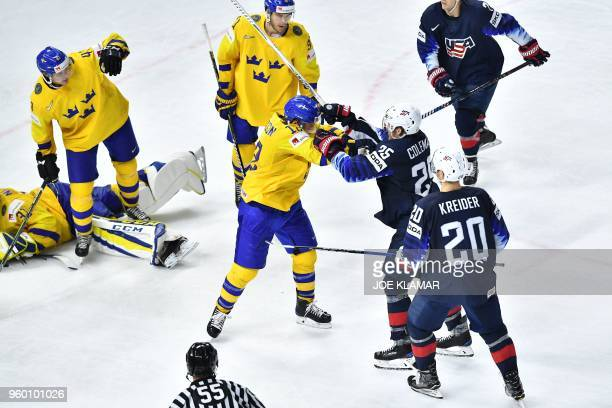 Sweden's Johan Larsson vies with United States' Blake Coleman during the semifinal match Sweden vs USA of the 2018 IIHF Ice Hockey World Championship...
