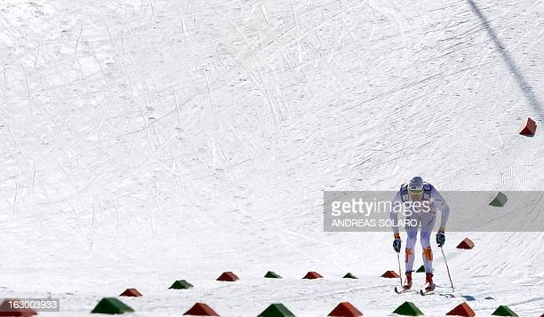 Sweden's Johan Olsson competes on March 3 2013 during the Men's Cross Country 50km race of the FIS Nordic World Ski Championships at Val Di Fiemme...
