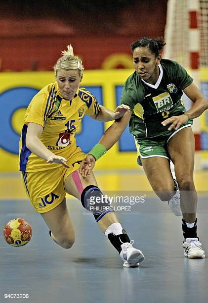 Sweden's Johanna Ahlm and Brazil's Ana Paula Rodrigues vie for the ball during the preliminary round match between Brazil and Sweden at the women's...