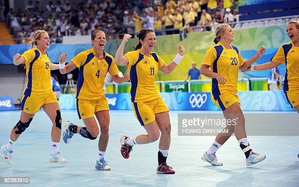 Sweden's Johanna Ahlm Matilda Boson Jessica Enstrom and Isabelle Gullden celebrate after their victory over Brazil in their Beijing 2008 Olympic...