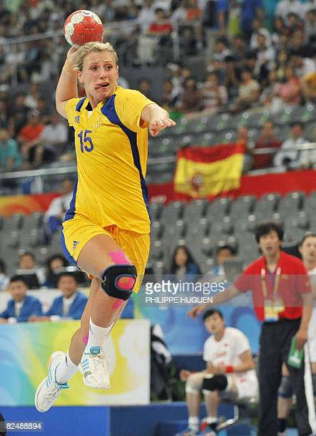 Sweden's Johanna Ahlm shoots at China's goal during a women's placement 58 handball match of the 2008 Beijing Olympic Games on August 21 2008 in...