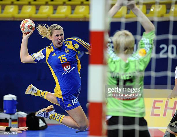 Sweden's Johanna Ahlm shoots at goal defended by Germany's goalkeeper Clara Woltering during the 8th Women's Handball European Championships match on...