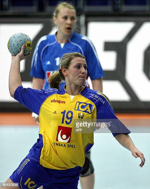 Sweden's Johanna Ahlm takes a shot during the Women's Olympic qualifying match Sweden vs Croatia in the eastern German town of Leipzig on March 30...