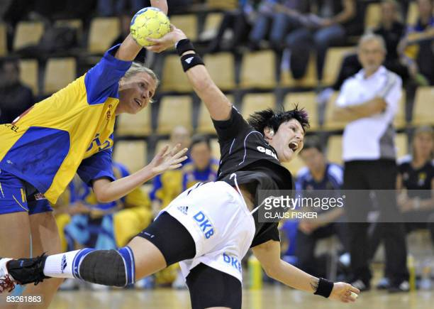 Sweden's Johanna Ahlm tries to stop Germany's Anja Althaus during their GF World Cup group B handball match on October 14 2008 in Aarhus Denmark AFP...