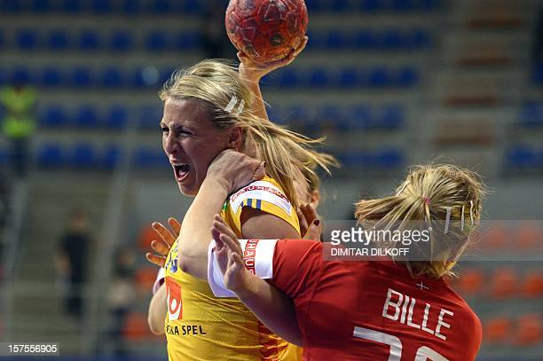 Sweden's Johanna Ahlm vies for the ball with Denmark's Kristina Bille during the Women's EHF Euro 2012 Handball Championship match between Sweden and...