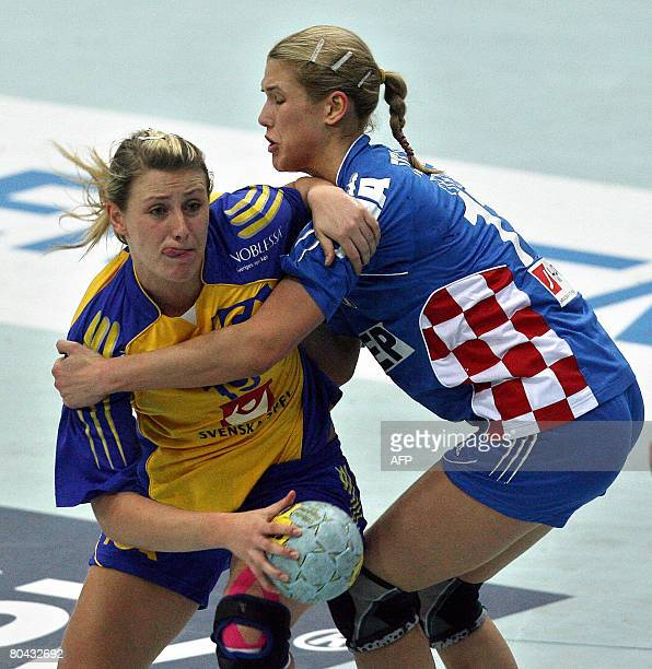 Sweden's Johanna Ahlm vies with Croatia's Maja Zebic during the Women's Olympic qualifying match Sweden vs Croatia in the eastern German town of...