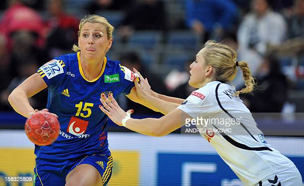 Sweden's Johanna Ahlm vies with Czech's Jana Knedlikova during their Women's EHF Euro 2012 Handball Championship match Czech Republic vs Sweden on...