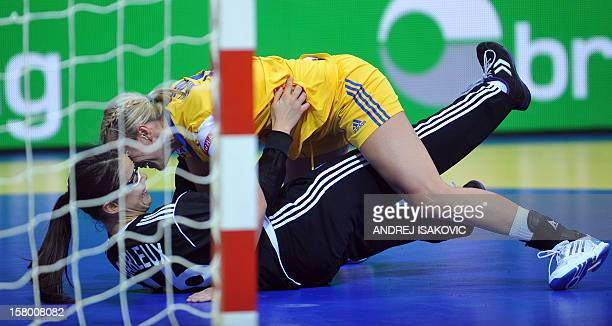 Sweden's Johanna Ahlm vies with France's goalkeeper Cleopatre Darleux during their Women's EHF Euro 2012 Handball Championship match Sweden vs France...