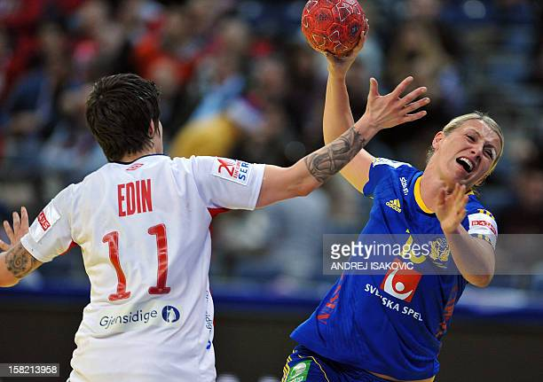 Sweden's Johanna Ahlm vies with Norway's Anja Edin during the Women's EHF Euro 2012 Handball Championship match Norway vs Sweden on December 11 at...
