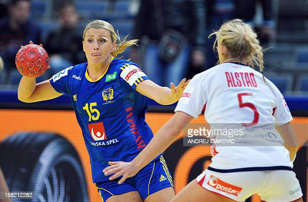 Sweden's Johanna Ahlm vies with Norway's Ida Alstad during the Women's EHF Euro 2012 Handball Championship match Norway vs Sweden on December 11 at...