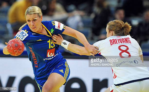 Sweden's Johanna Ahlm vies with Norway's Karoline Dyhre Breivang during the Women's EHF Euro 2012 Handball Championship match Norway vs Sweden on...