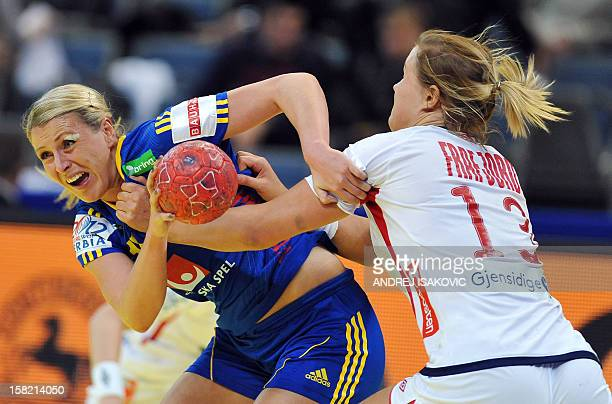 Sweden's Johanna Ahlm vies with Norway's Marit Malm Frafjord during the Women's EHF Euro 2012 Handball Championship match Norway vs Sweden on...