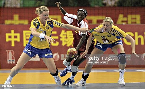 Sweden's Johanna Wiberg and Johanna Ahlm vie for the ball against Congo during their first round match at the 2009 World Women's Handball...