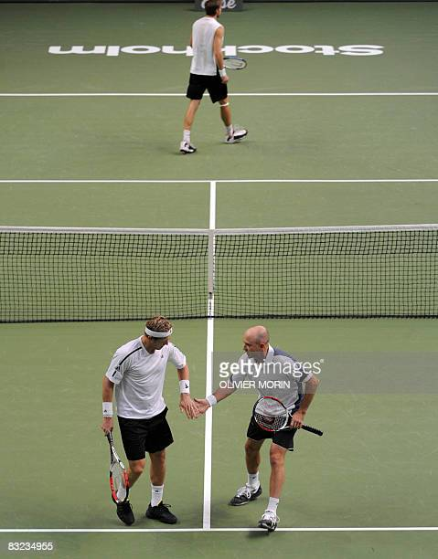 Sweden's Jonas Bjorkman and his teammate Zimbabwe's Kevin Ullyet react during their doubles final match against compatriots Johan Brunstrom and...