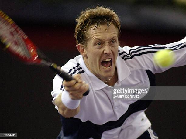 Sweden''s Jonas Bjorkman returns a ball to his Russian opponent Marat Safin during their Madrid Masters Series first round match 14 October 2003 at...